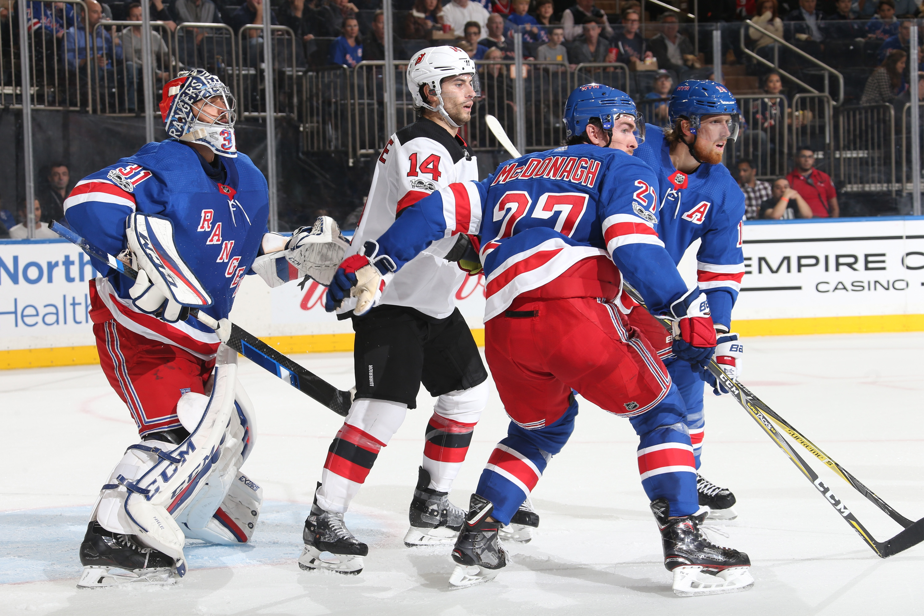 Rangers get the points they need with hard-fought win over Devils